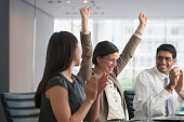 Business people cheering in meeting