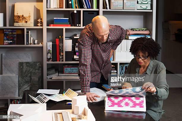 Business people choosing wallpaper in office