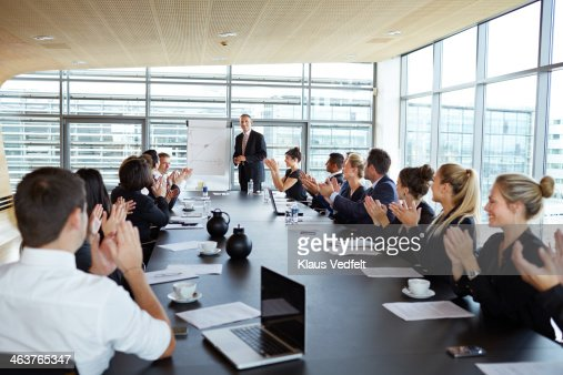 Business people clapping at big presentation : Stock Photo