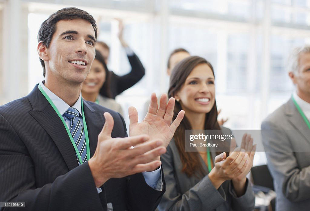 Business people clapping at seminar in office