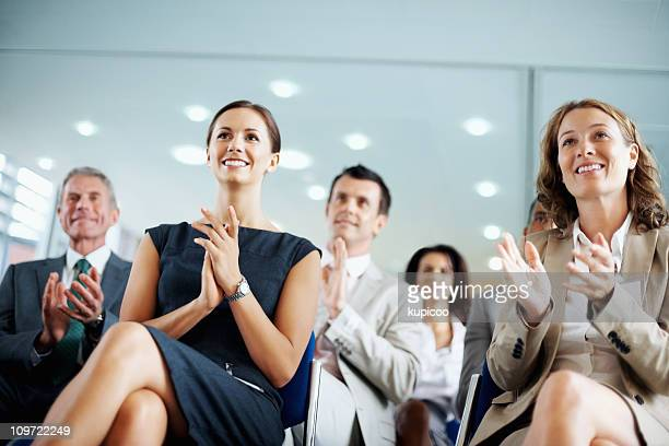 Business people clapping for a good presentation in boardroom