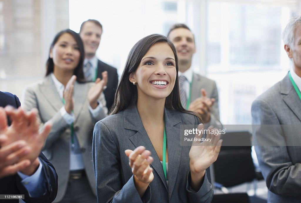Business people clapping in seminar : Stock Photo