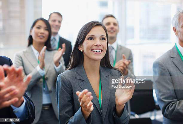 Business people clapping in seminar