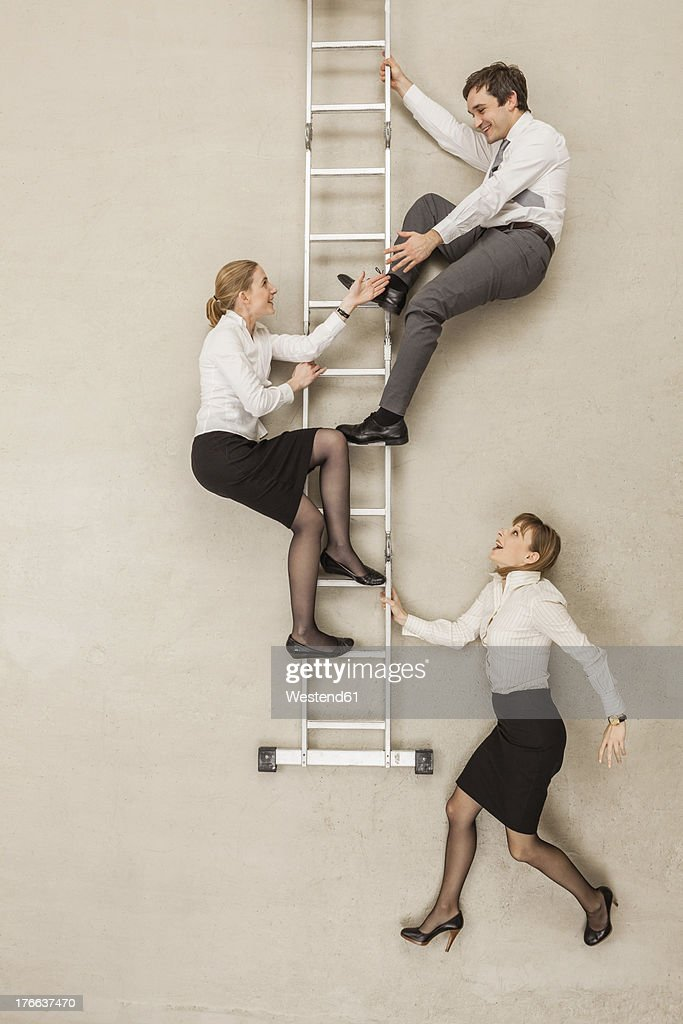 Business people climbing ladder