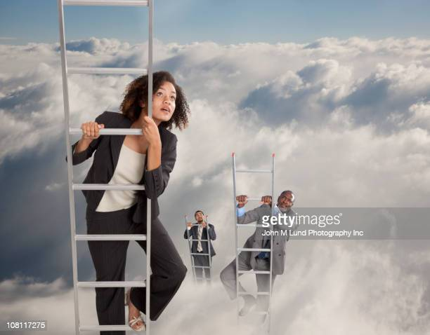 Business people climbing ladders into clouds