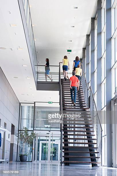 Business people climbing office stairs