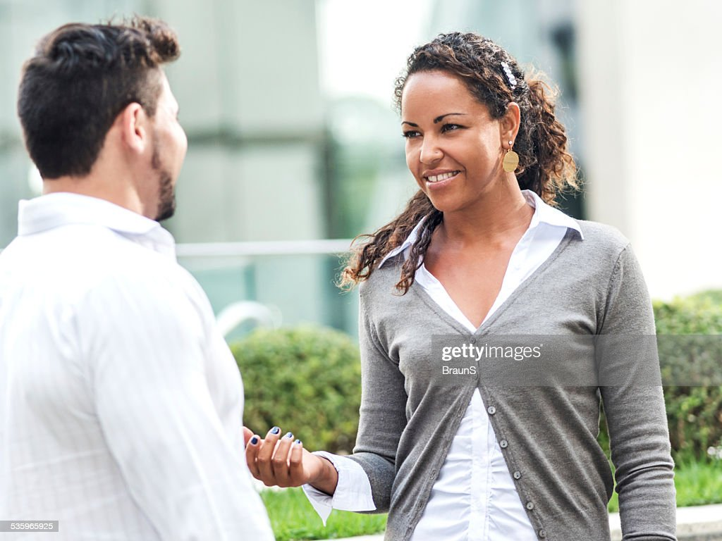 Business people communicating outdoors. : Stock Photo