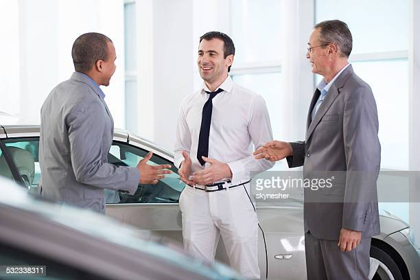 Business people communicating to a salesperson.