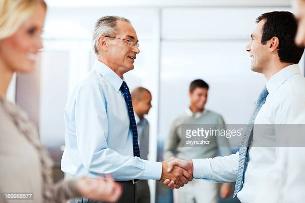 Business people congratulating each other