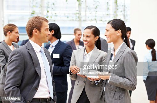 Business People Conversing at a Conference
