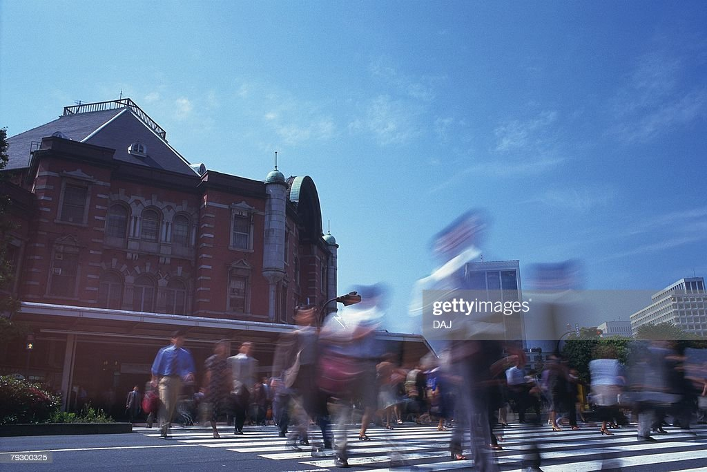 Business people crossing at the crosswalk, low angle view, blurred motion, Tokyo Station, Tokyo, Japan