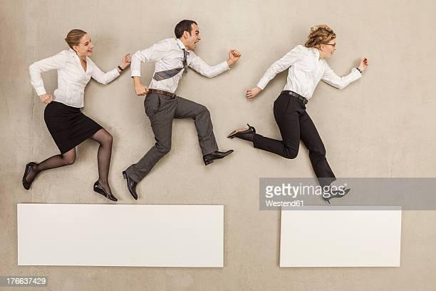 Business people crossing gap of platform