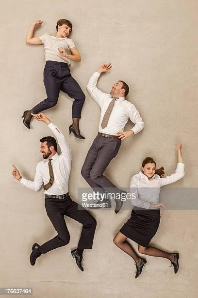 Business people dancing in office