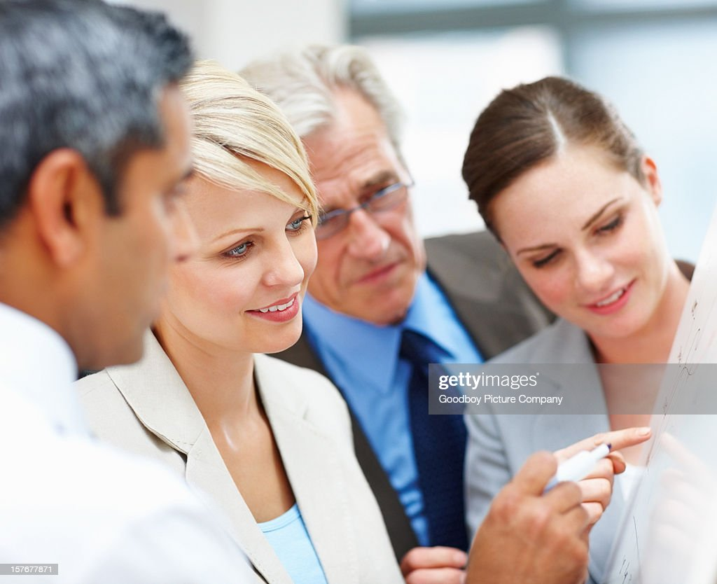 Business people discussing a new project at board meeting : Stock Photo
