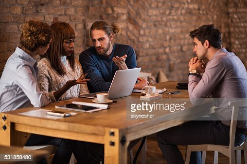 Business people discussing about potential colleague at job interview.