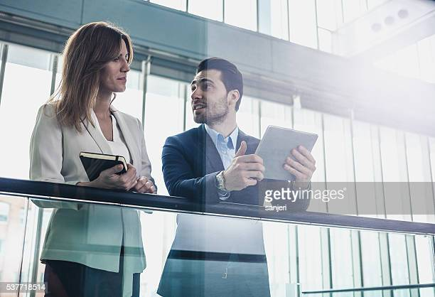 Business people discussing at the lobby