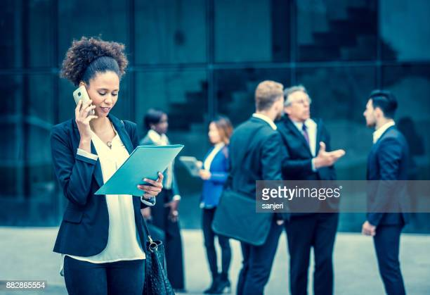 Business People Discussing in Front of Building