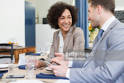 Business people discussing in restaurant : Stock Photo