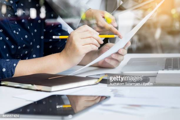 Business People Discussing Over Document In Meeting At Office