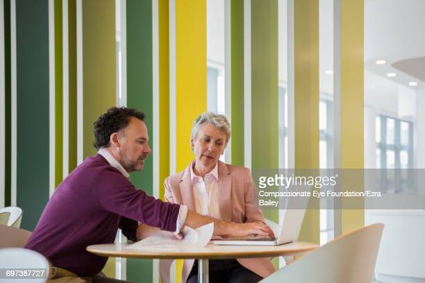 Business people discussing plans in cafe