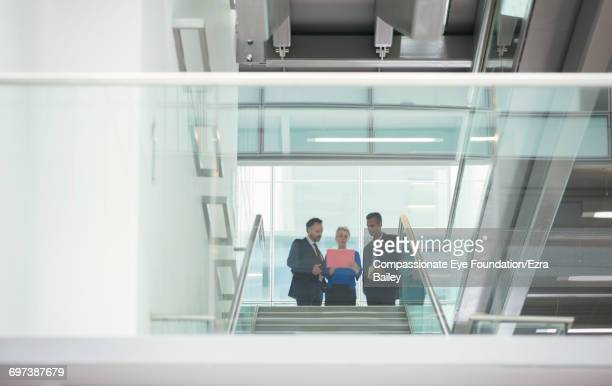 Business people discussing plans in modern office