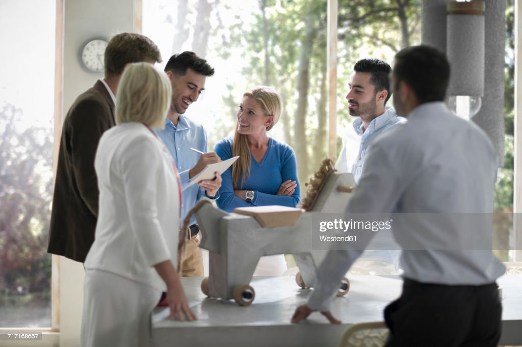 Business people discussing product design at team meeting : Stock Photo
