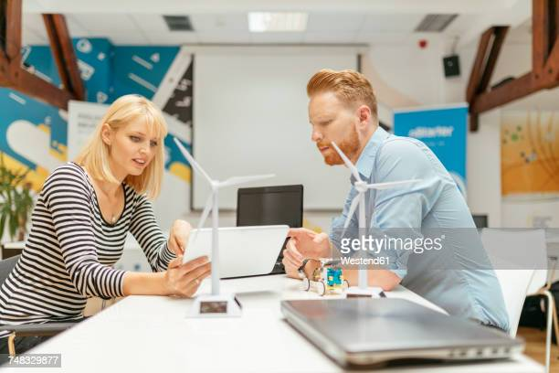 Business people discussing project in office