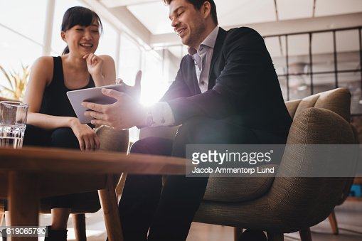 Business people discussing project on digital tablet : Stock Photo