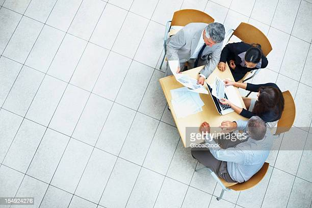 Business people discussing work on laptop