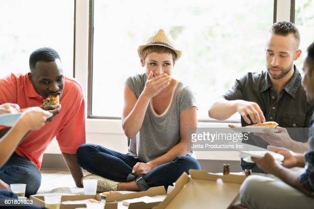 Business people eating in office meeting