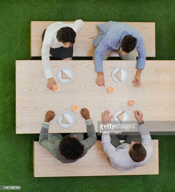 Business people eating together at table