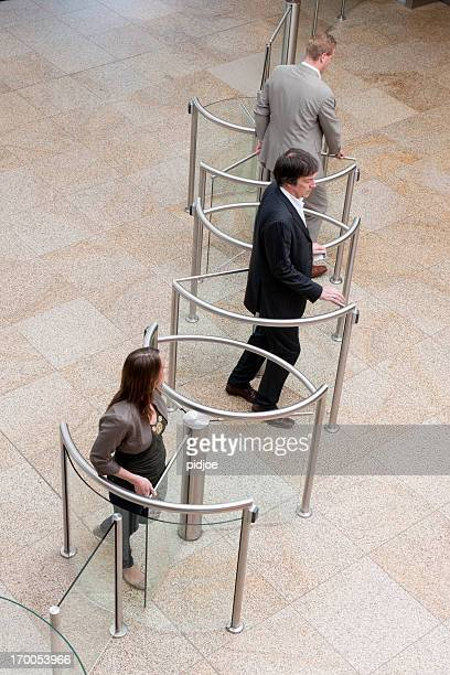 business people entering lobby