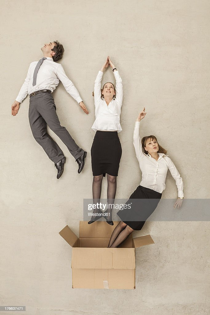 Business People Flying Out Of Cardboard Box Stock Photo