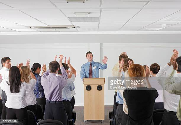 Business people giving standing ovation
