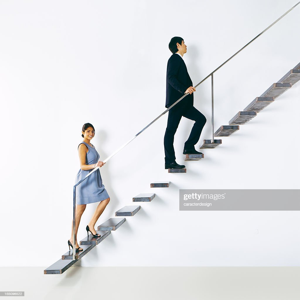Business people going up