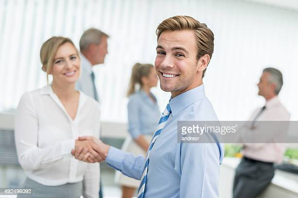 Business people handshaking at the office