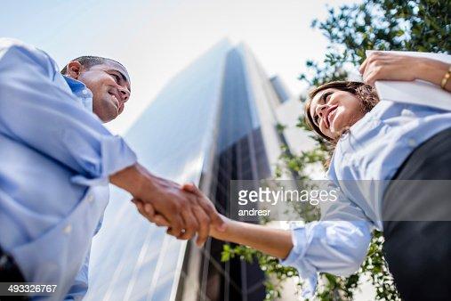 Business people handshaking