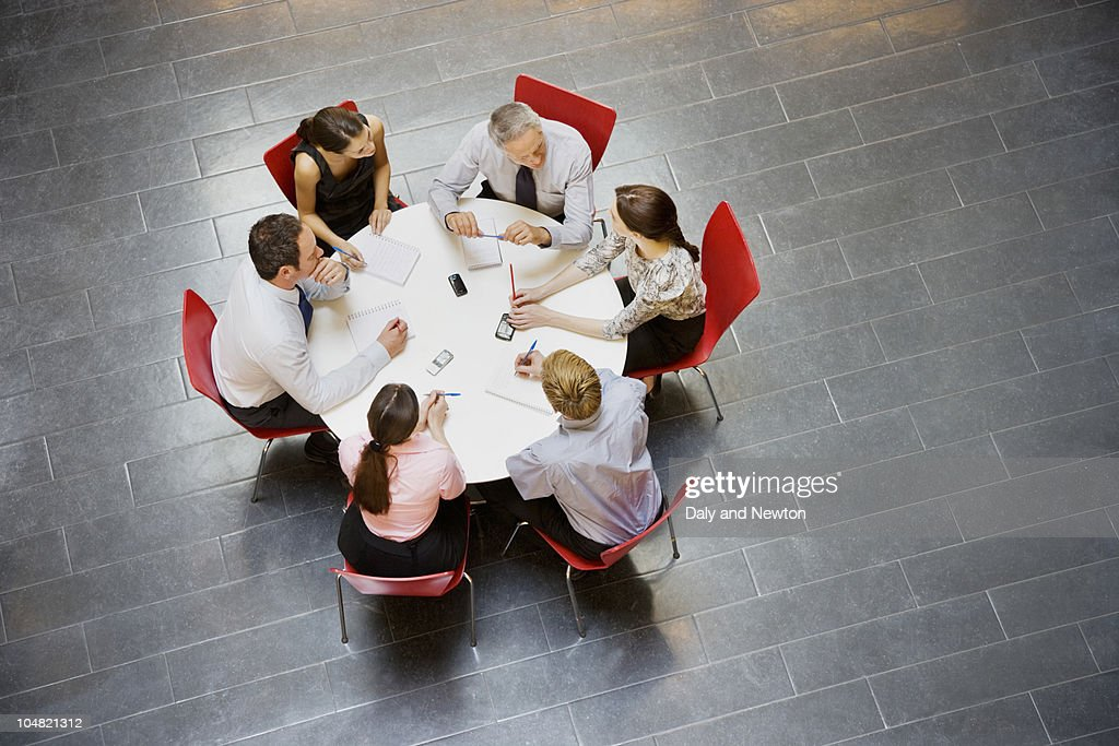 Business people having a meeting at round table : Stock Photo