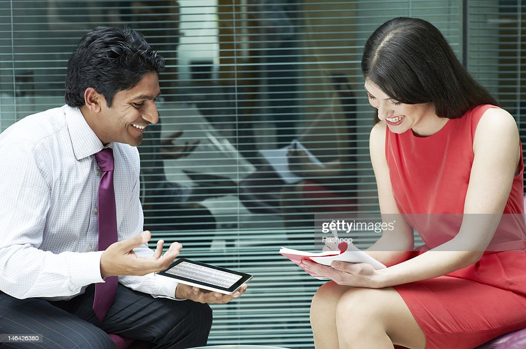 Business people having an informal meeting : Stock Photo