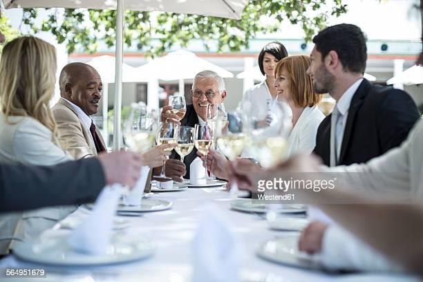 Business people having business lunch in restaurant