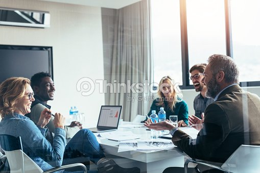 Business people having casual discussion during meeting : Stock Photo