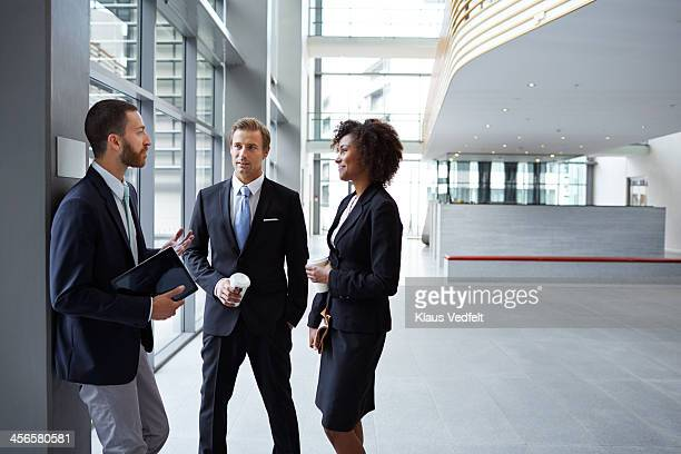 Business people having casual meeting in hall