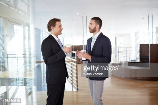 Business people having casual meeting with coffee : Stock Photo