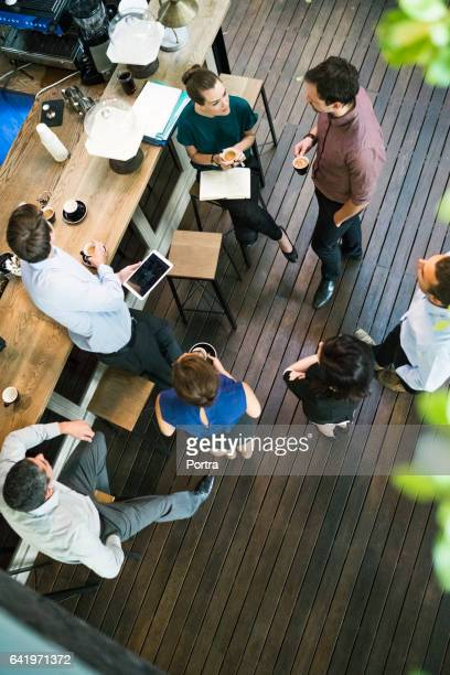 Business people having coffee in office cafe