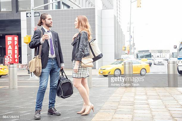 Business people having coffee on the go, New York, USA