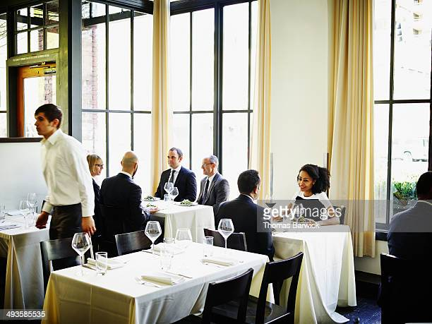 Business people having lunch in restaurant
