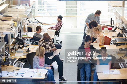 Business people having meeting in busy office