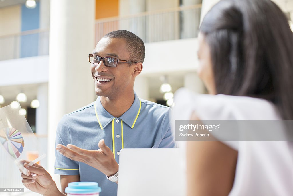 Business people having meeting in cafe : Stock Photo