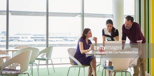 Business people having meeting in cafe