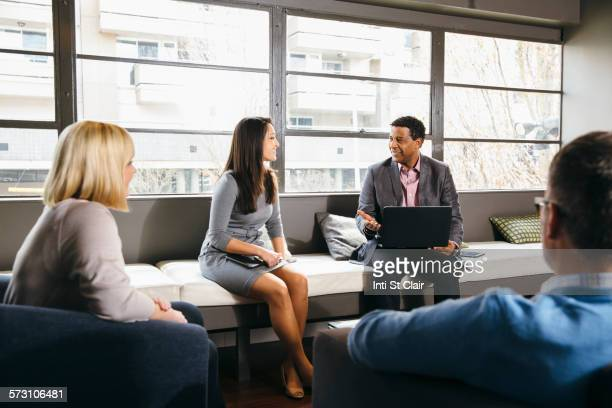 Business people having meeting in office lounge